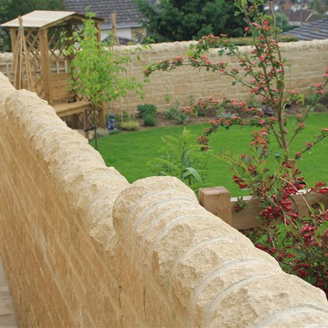 Cotswold village cottage with walling stone cappings