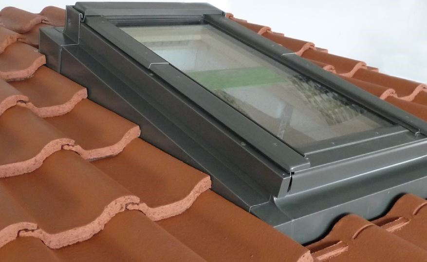 Low pitch roof window system with roof tiles