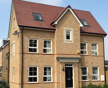 Barratt homes case study with gemini roof tiles and cast stone window surrounds