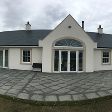 A panoramic image of a cast stone cast study including window surrounds, door surround and stone cills